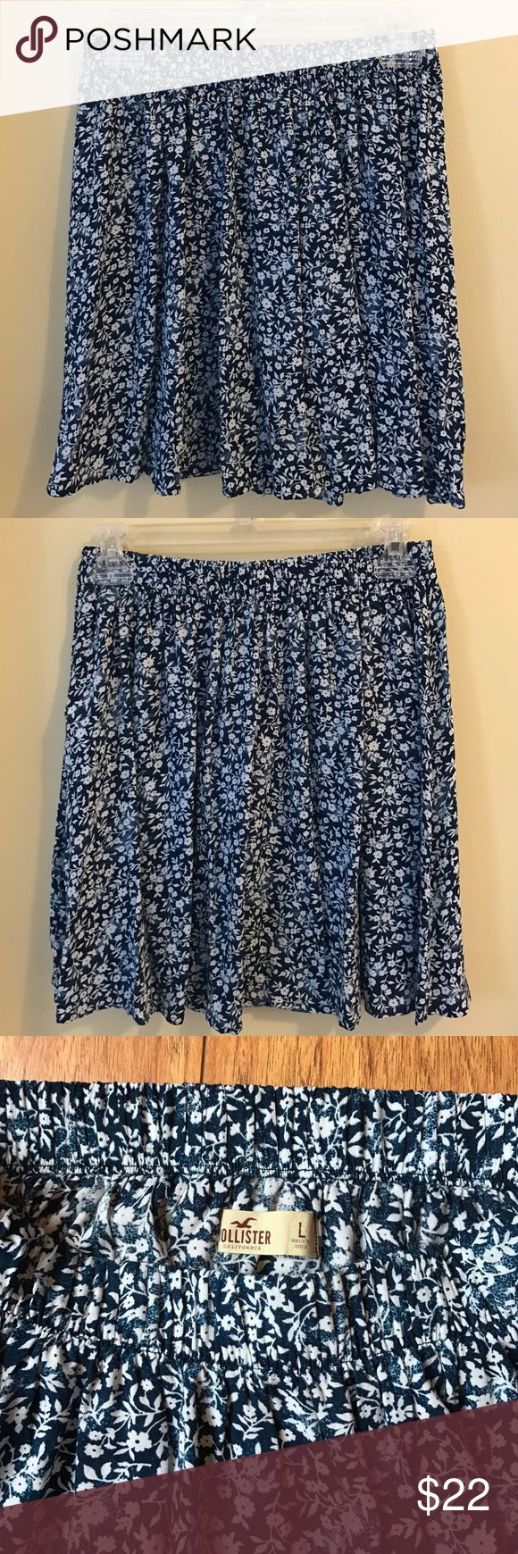 """Hollister Skirt NWOT Very cute Hollister swingy skirt! Gathered at elasticized waist. Navy with white flowers. 17"""" inches long. Never worn. Hollister Skirts Mini"""