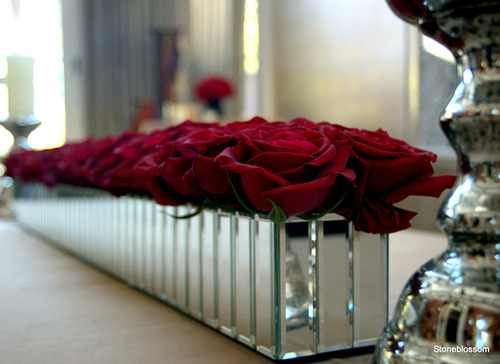 Long rectangle glass centerpiece with red roses projects