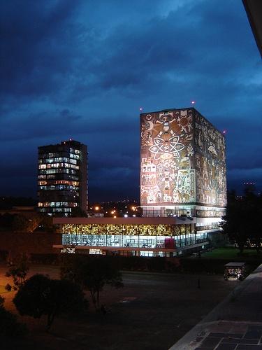"Mexico D.F. city  Mexican University  ""Universidad Nacional de México.'' Art work: Murales De Siquerios  UNAM iluminada de noche"