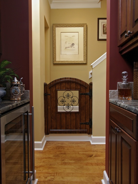 I love this custom wood baby gate with the iron inset!