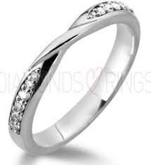 Image result for graduated diamond channel set wedding band with crossover