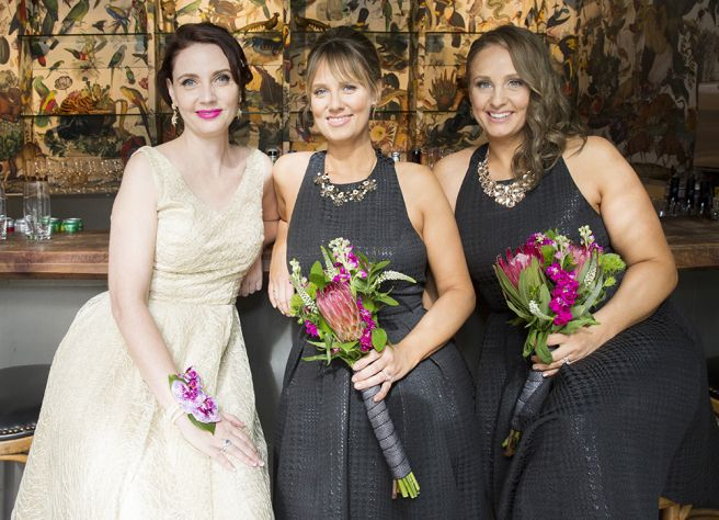 Flowers by Teresa Soleau. Photo by Monica Orozco and Jeff Loftin. Bouquets. Protea. Veronica. Magenta. Green. White.