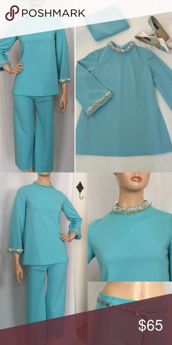 """Vintage Mad Men Turquoise Pant Suit This fabulous vintage pant suit has a tunic style top with disc sequins and bead accents on the collar and cuffs and a back zip closure. The tunic measures bust 34"""", neck 13"""", sleeves 20"""", length 25"""". The pants have a back zip closure and measure waist 26"""", hips 35"""", front rise 11"""", inseam 23"""". The pants are cropped and have a low waist fit measuring 32 1/2"""" around (see pic 2). Mannequin measurements are 33"""", 25"""", 35"""", stands 5'8"""". Based on measurements…"""