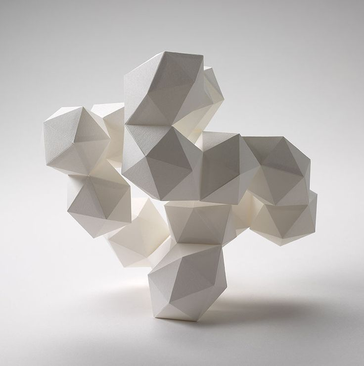 "Daryl Ashton 3D Geometric (white-on-white). Paper. Actual size 5""L x 7W"" x 7.5""H. - This multifaceted geometric design is a free standing three dimensional piece. It is made of sixteen 20-sided icosahedrons, which perch precariously on just 2 triangle faces"