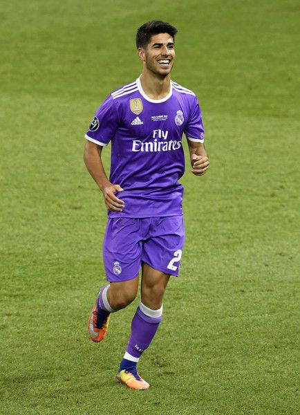 In this handout image provided by UEFA, Marco Asensio of Real Madrid celebrates scoring his sides fourth goal during the UEFA Champions League Final between Juventus and Real Madrid at National Stadium of Wales on June 3, 2017 in Cardiff, Wales.