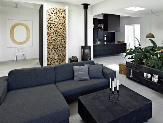 TheDesignerPad - The Designer Pad - SHARP ANDBEAUTIFUL black and white living room with stacked wood