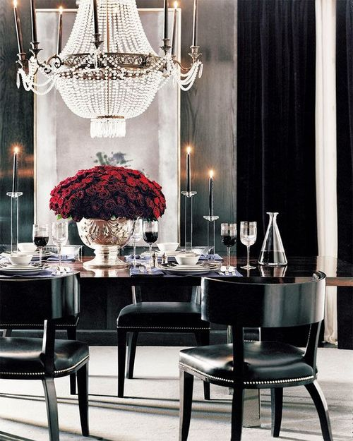 So pretty and elegant dining room. Awesome red flowers in a black furniture.