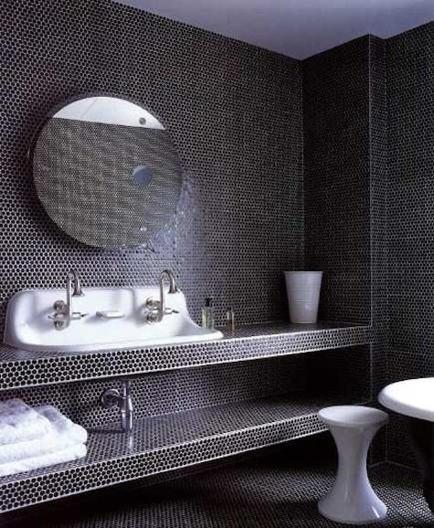 black pennyround tiled bathroom with lab sink