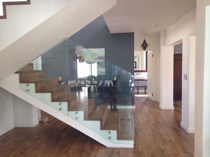 Glass stair case balustrade. It the best thing we ever did. It makes the house so open and of course the wooden flooring is seamless throughout the house.