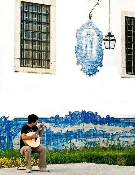 Fado played with a #portuguese guitar and a background of azulejos (hand painted tiles) #Lisbon