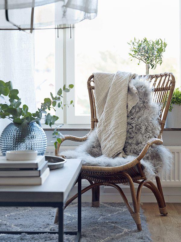 Living room details. Rattan, linen, wool, greens