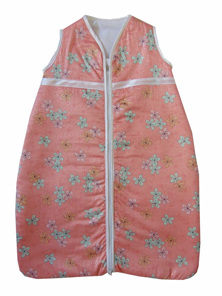 Lovely peach with flowers design baby sleeping bag. Size 0-6 months. Satin trim to arms, neck and zip edge. Two layers of soft cotton with cosy inner batting. Central zip from bottom to top for ease of changing. R350