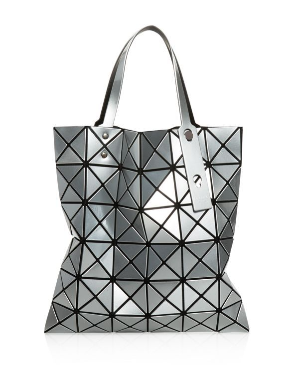 With its edgy, geometric design, Issey Miyake's cult-favorite design is a tote-al head-turner. | Polyvinyl Chloride, Base Polyester, Partly Nylon, Brass, Polyurethane | Imported | Double adjustable ha