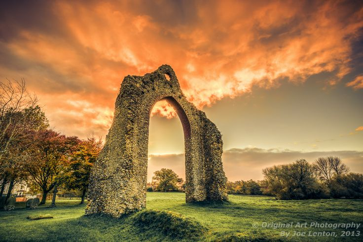 At the back of Wymondham Abbey in Norfolk are some ruins from an old part of the Abbey. This archway stands intact and almost looks like a gateway to another world with the fiery sunrise behind it!