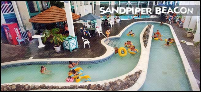 Indoor Lazy River Ride - Sandpiper Beacon Beach Resort in Panama City Beach, FL