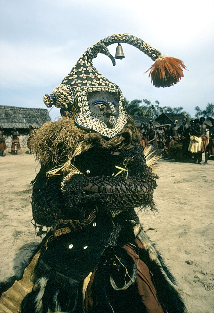 Africa | Dance of the mukyeem (mukenga) mask, Muentshi, Congo (Democratic Republic) | © Eliot Elisofon, 1972. | Mukyeem, also called mukenga, is morphologically a variant of the moshambwooy mask. It is crowned with a bent-forward representation of an elephant trunk with two tusks. The mukyeem mask does not appear in the immediate vicinity of the king, but rather is seen among the Kete, Ngongo, Ngeende, and also with some other constituent peoples of the Kuba kingdom.