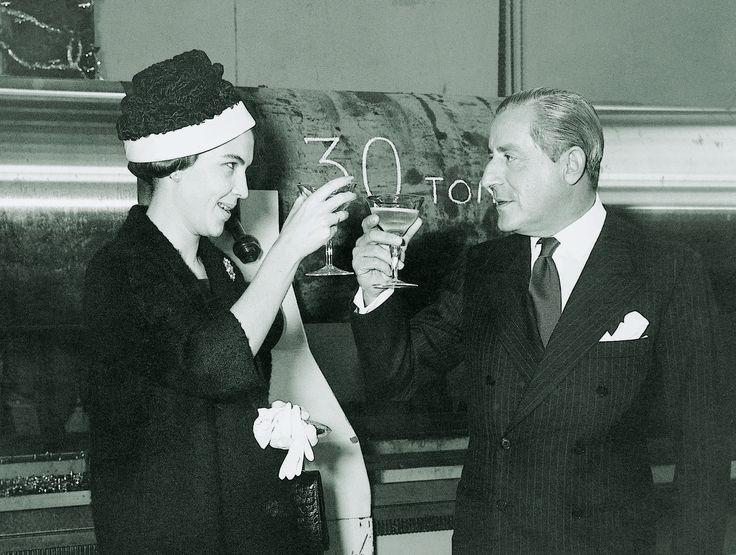"The founder of the Hellenic Shipyards S.A.  Stavros Niarchos with Amalia C. Caramanlis, sponsor of the tanker WORLD HOPE on the 22nd December 1960. The WORLD HOPE was the first ship built by the above shipyards. / Ο ιδρυτής των Ελληνικών Ναυπηγείων, Σταύρος Νιάρχος με την Αμαλία Κ. Καραμανλή, ανάδοχο του δεξαμενοπλοίου "" WORLD HOPE"" στις 22 Δεκεμβρίου 1960. Το ""WORLD HOPE"" ήταν το πρώτο πλοίο που κατασκευάστηκε στα εν λόγω ναυπηγεία."