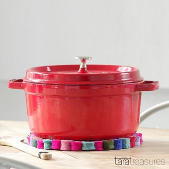 """Colourful Spirals Pot Trivet. Beautiful and functional, this felt pot trivet in """"delicious"""" colours is made to withstand heat without damaging your tabletop. We have always used this pot trivet as a pretty placemat when transfering the cast iron pot from the cooktop to the tabletop."""