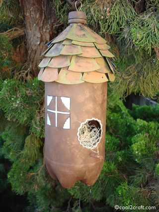 Plastic Bottle Birdhouse from Cool2Craft    paint, cd disks cut into triangles,