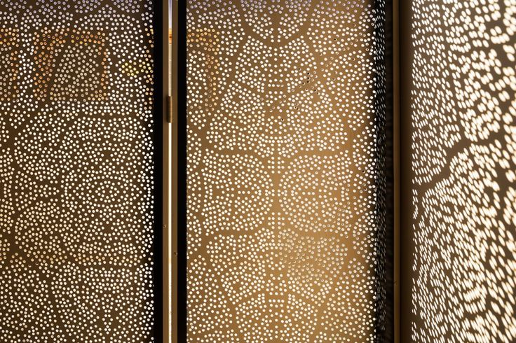 K House / Studio Arthur Casas, metal, perforated, pattern, copper, brass