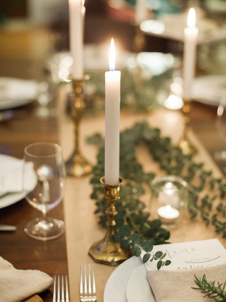 Organic Fall Gathering Tablescape | Portland, Oregon — linen napkins, eucalyptus & rosemary greens, brass candlesticks, candles