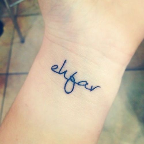 """Little wrist tattoo saying """"ehfar"""", meaning """"Everything happens for a reason""""."""