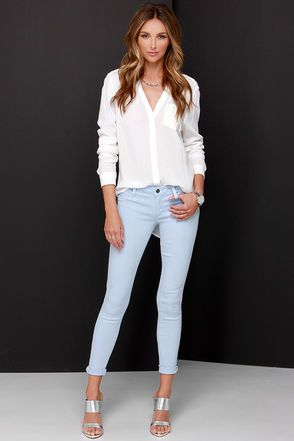 Everything you've heard about the Tractr Modern Myth Light Blue Skinny Jeans being oh-so-awesome is true! Soft, pale blue stretch denim shapes a low-rise fit, hidden zip fly and top button closure. Two front faux pocket, real coin pocket and two back patch pockets top the cute, skinny pant legs that taper at the ankles. Unlined. 71% Tencel. 28% Cotton, 1% Spandex. Machine Wash Cold. Imported.