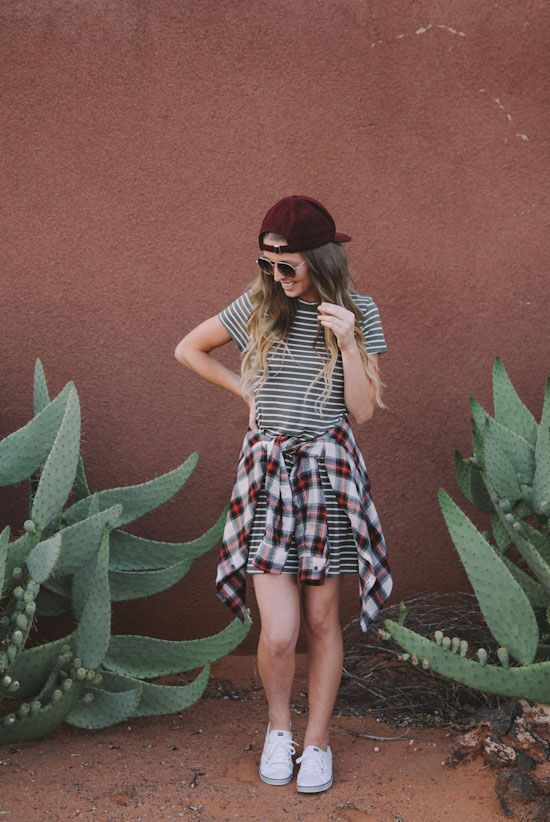 summer outfit, spring outfit, game day outfit, casual outfit, athleisure, sneakers outfit, street style - grey stripe t-shirt dress, red plaid shirt, white sneakers, burgundy baseball cap, aviator sunglasses