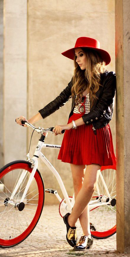 I once dreamt I rode my bicycle down the street in my neighborhood on a sunny day, wearing a beautiful pleated red skirt