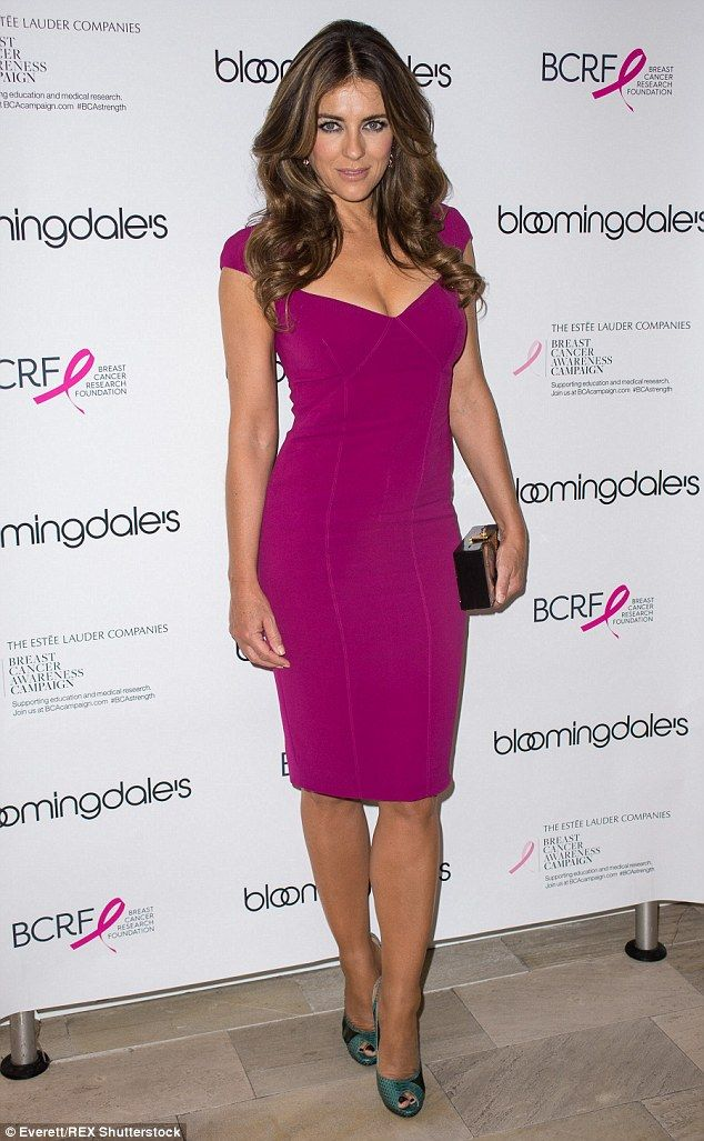 Hot pink: Liz Hurley wore a form-fitting pink dress as she attends an event to promote Breast Cancer Awareness month at Bloomingdale's in New York on Wednesday