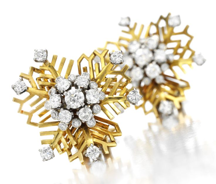 A pair of diamonds and gold 'snowflake' ear clips by Van Cleef and Arpels, circa 1938