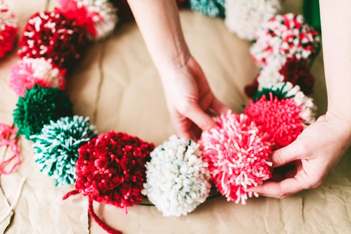 Make your own pom pom wreath.