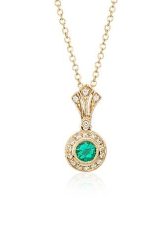 Inspired by vintage jewelry, this sophisticated 14k yellow gold pendant features a milgrain halo with pavé-set diamonds that frame a beautiful emerald.