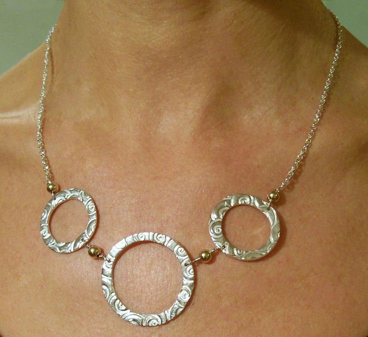 Designed and made by Nuit Nuit. 3 Pure silver (.999) circles with 9crt gold filled beads on a sterling silver belcher chain
