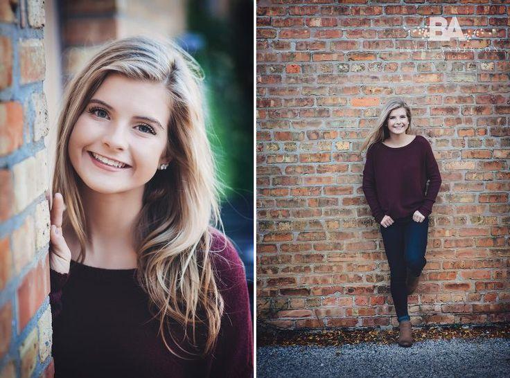 Britt Anderson Seniors senior girl posing urban brick wall