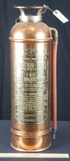 ANTIQUE COPPER AND BRASS PEERLESS FIRE EXTINGUISHER. GEORGE CARPENTER COMPANY, CHICAGO. THIS ANTIQUE FIRE EXTINGUISHER IS ABOUT AS NICE AND CLEAN AS THEY GET. IT HAS BEEN PERSONALIZED AND READS MARY AND WALLY JUNE 4TH 1975. MEASURES 24 INCHES TALL. GREAT PIECE OF ANTIQUE FIREHOUSE MEMORABILIA.