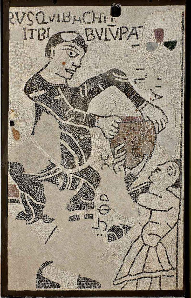"""""""Frate che porge un otre a un giovane"""" / Mosaico, cm 185 x 118 / Pavimento della Cattedrale di Reggio Emilia, Secondo quarto del XII secolo / Piano 1 – Atrio dei Mosaici"""
