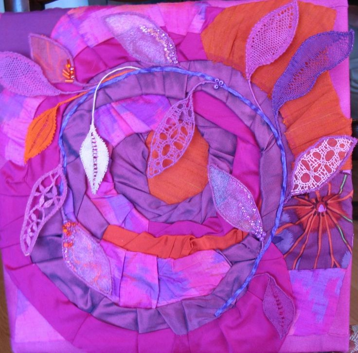 """""""Autumn Vortex"""" by Cheryl Ford. Includes leaves made using bobbin lace techniques.  Made for a challenge with the theme of magenta."""