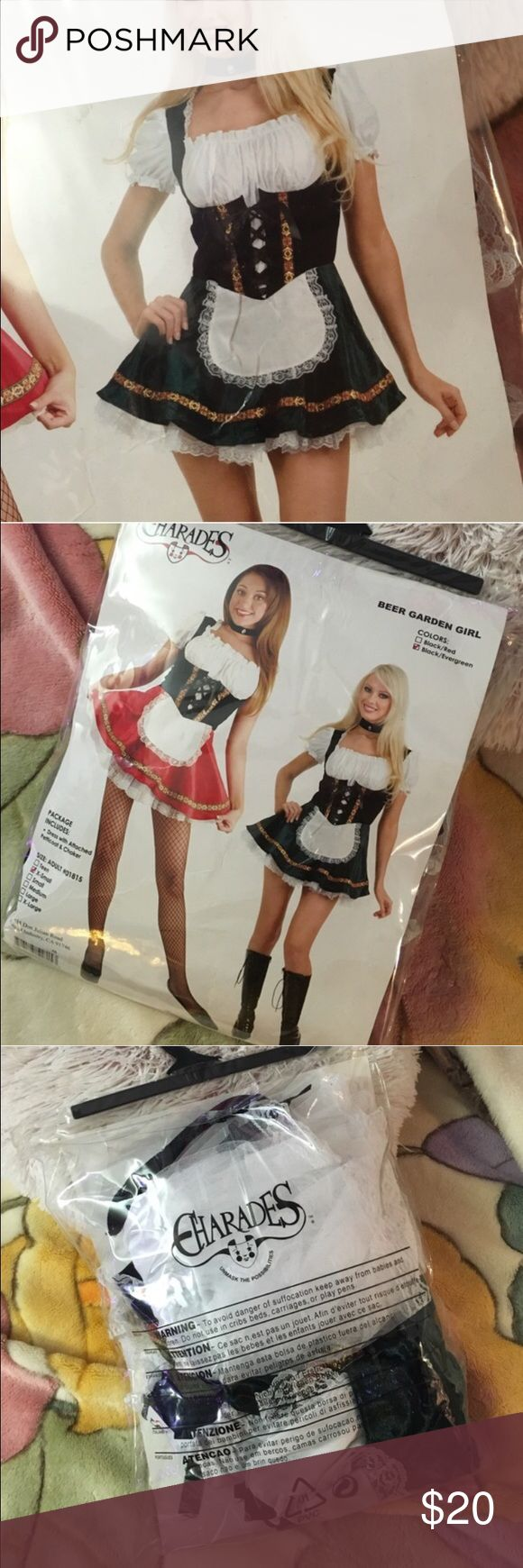 ✨nwt✨ beer garden girl costume got this as a gift & wanted to wear it to oktoberfest but never got a chance to go. black/green. comes with dress with attached petticoat & choker. never worn and has no flaws! not from listed brand (exposure). Hot Topic Dresses