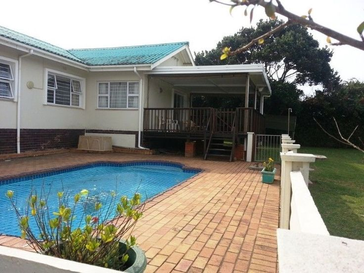 SOLE MANDATE : Business opportunity set next to a beacon in Sea Park, on the busy R102 linking Hibberdene to Port Shepstone.This Property boasts 4 spacious bedrooms 2 with on suites, a separate toilet and a full bathroom. All rooms with built in cupboards.A large open plan lounge / dining room with a beautiful built in bar, most of the floors is covered with parquet flooring . A nice kitchen with the empasis on functionality further enhances this property .The Lounge leads on to an…