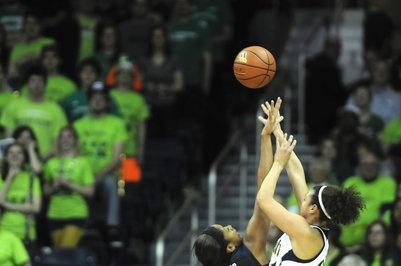 UConn forward Morgan Tuck, left, defends Notre Dame guard Kayla McBride on Monday night.