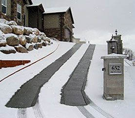 Possibly under a green driveway? WarmZone - Heated driveway with brick pavers.