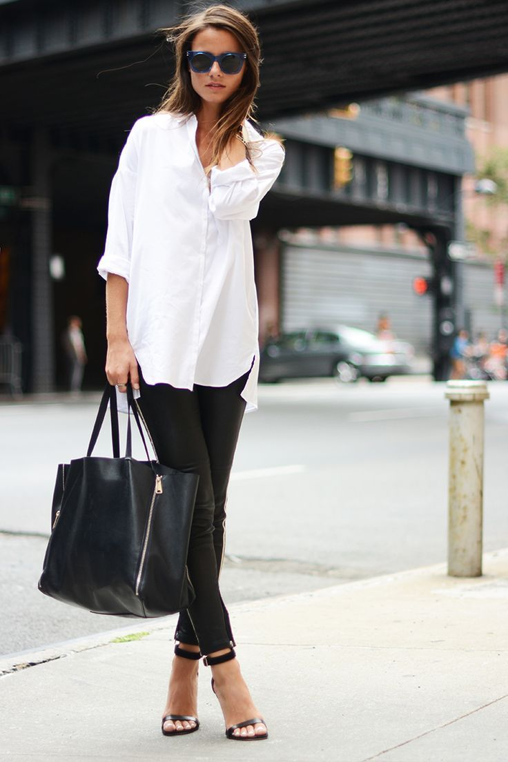 This combination of a white chiffon classic shirt and black leather slim pants is perfect for a night out or smart-casual occasions. Finish off your look with black leather heeled sandals.   Shop this look on Lookastic: https://lookastic.com/women/looks/dress-shirt-skinny-pants-heeled-sandals-tote-bag-sunglasses/9923   — Navy Sunglasses  — White Chiffon Dress Shirt  — Black Leather Skinny Pants  — Black Leather Tote Bag  — Black Leather Heeled Sandals