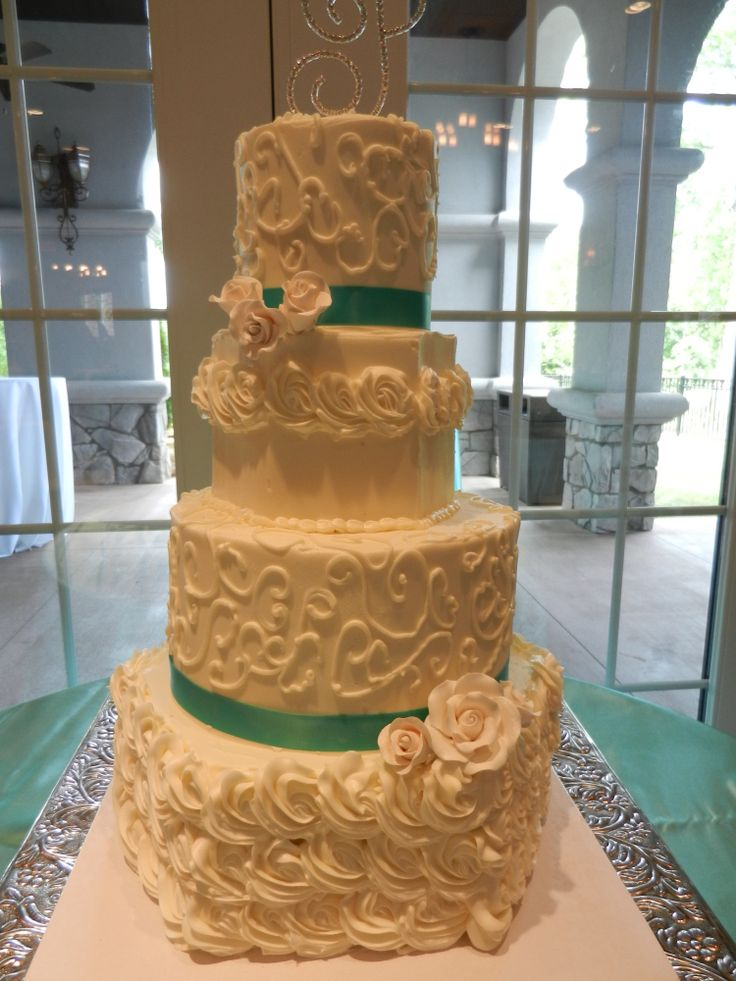 rosettes and scrolls wedding cake wwwcheesecakeetcbiz wedding cakes charlotte nc