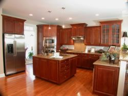Gorgeously designed kitchen, Huge island, hardwood floors, granite countertops, lots of cabinet space.
