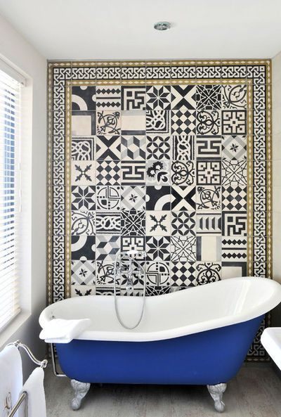 Cobalt tub with patterned tile wall.