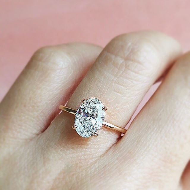 Oval perfection. 👌  Our signature Aura oval diamond ring is customizable in any size center stone and metal. 💍 Shop link in bio for pricing and details or contact us for more info. Tag your girls! 👯