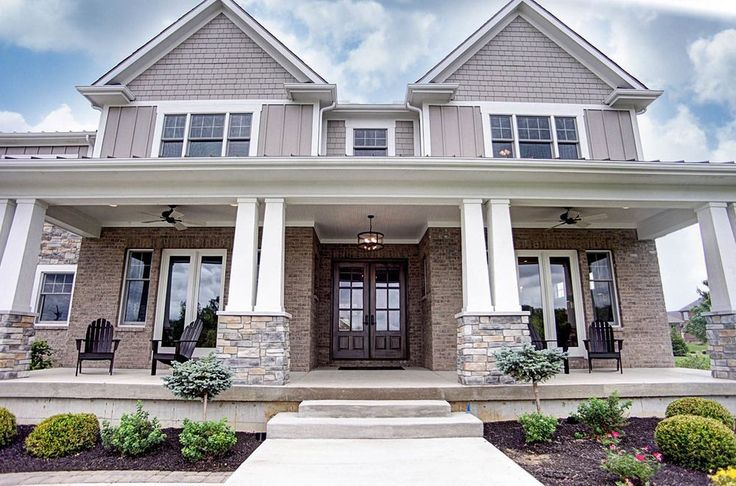 Traditional Exterior of Home with exterior stone floors, Pathway, exterior brick floors, Wrap around porch