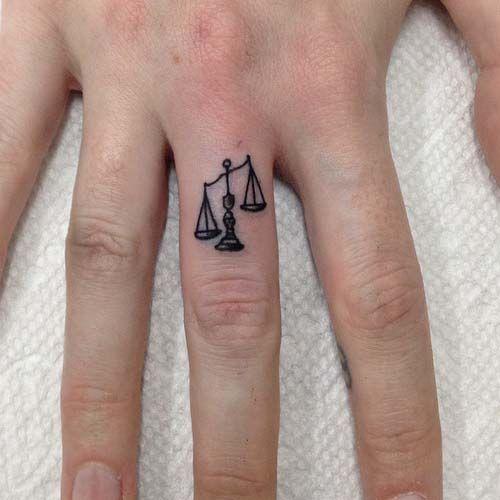 libra finger tattoo