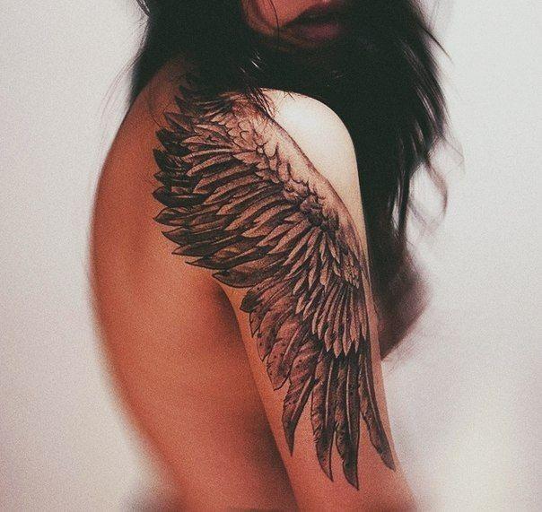 One black wing tattoo on shoulder for girls - Tattooimages.biz